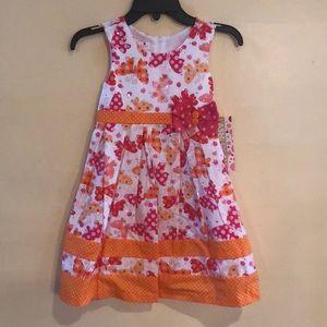 Orange/white flowered dress with sparkles
